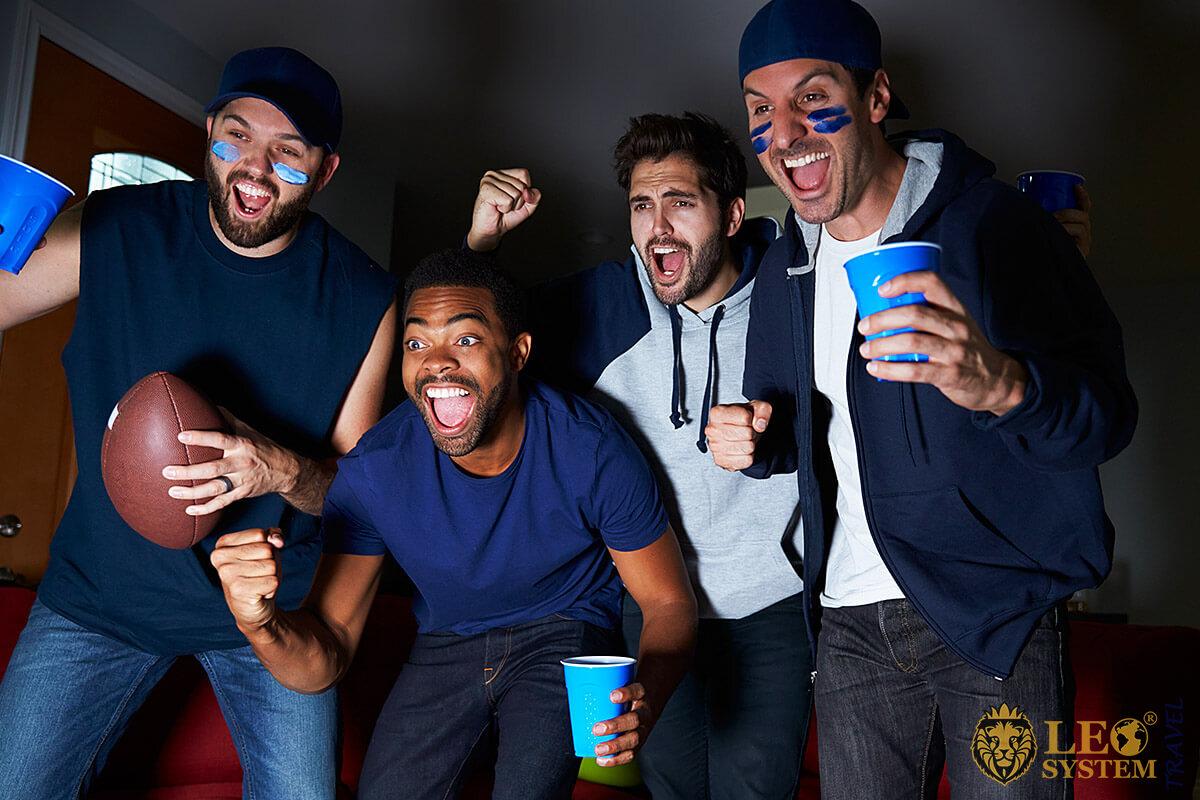 American football fans watching TV