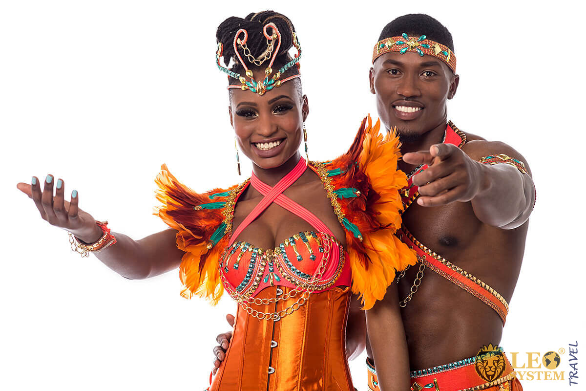 Joyful African couple in outfits