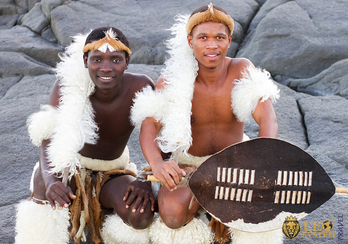 Two African young men with traditional symbols
