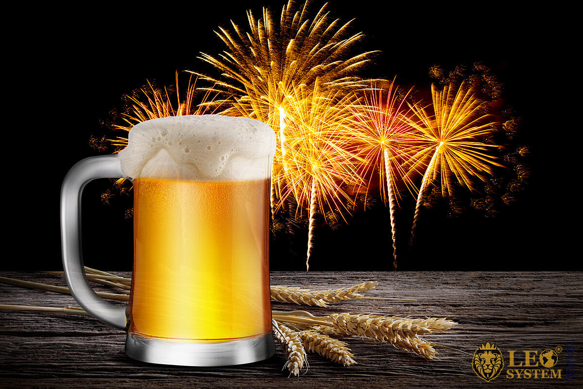 Image of a glass of beer on a background of fireworks
