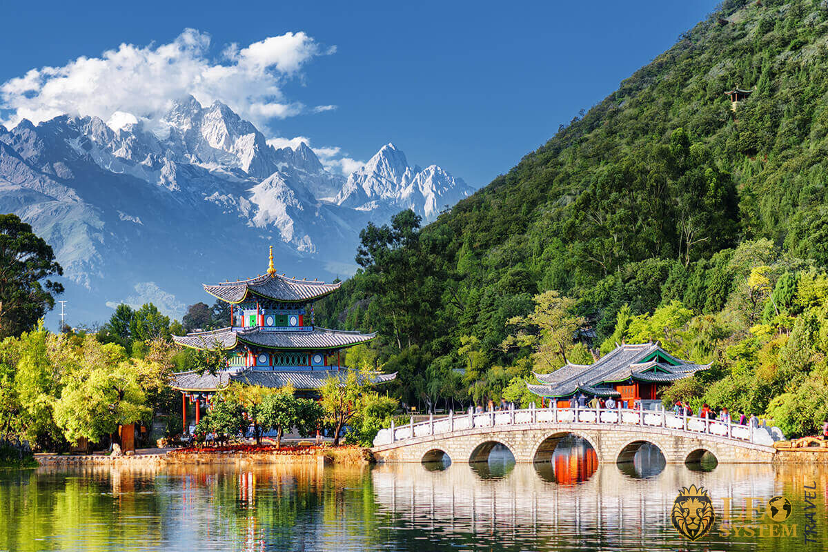 Great view of the Jade Dragon Snow Mountain and the Black Dragon Pool, Lijiang, Yunnan province, China