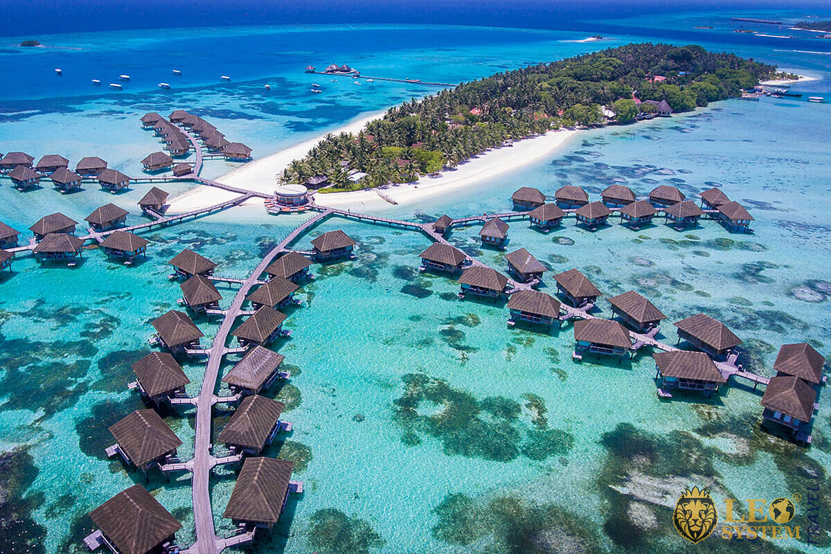 Top view of the island in the Indian Ocean and houses, Maldives