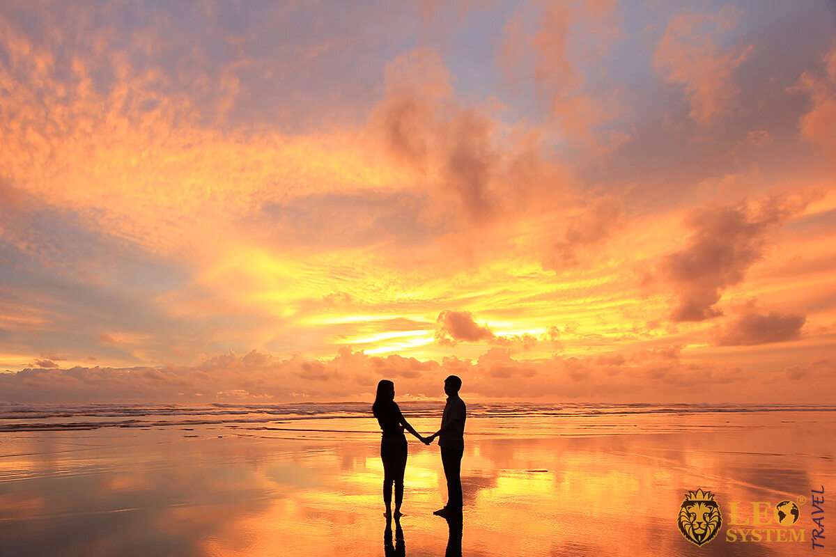 Image of two people at sunset