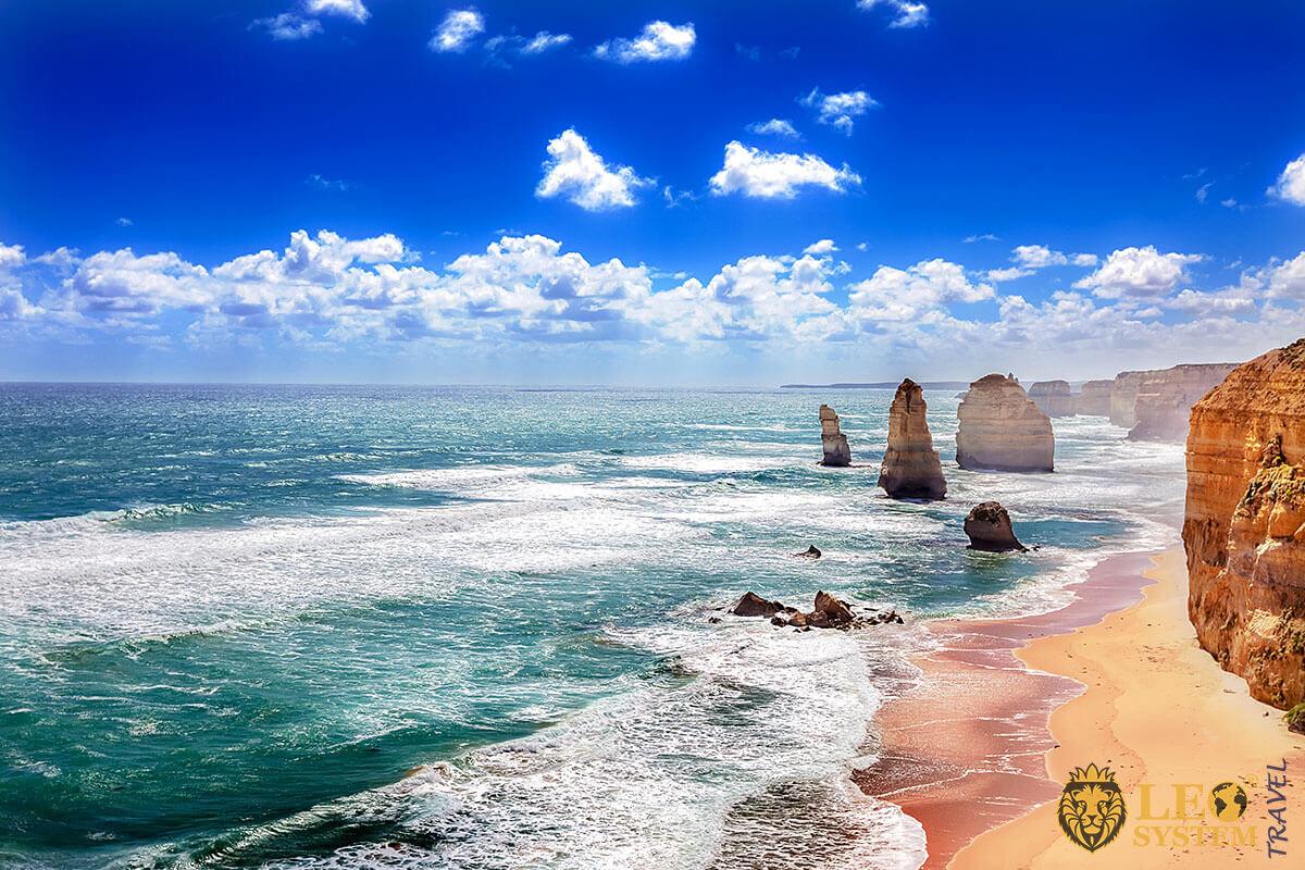 Twelve Apostles and orange cliffs along, Australia
