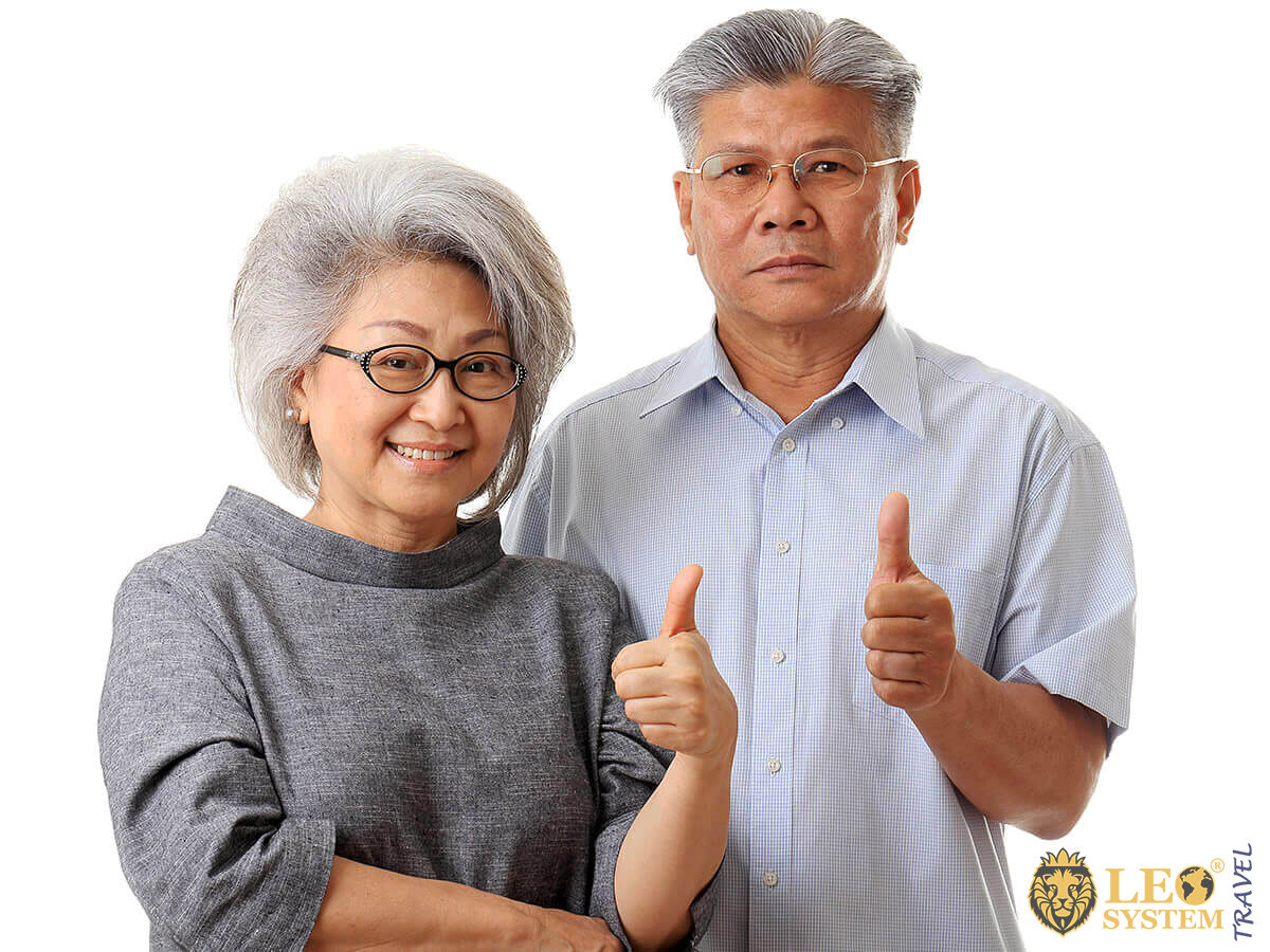 Happy elderly Asian couple