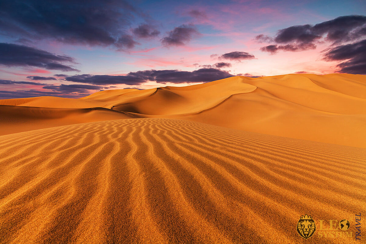 Image of the Sahara Desert at sunset, continent Africa