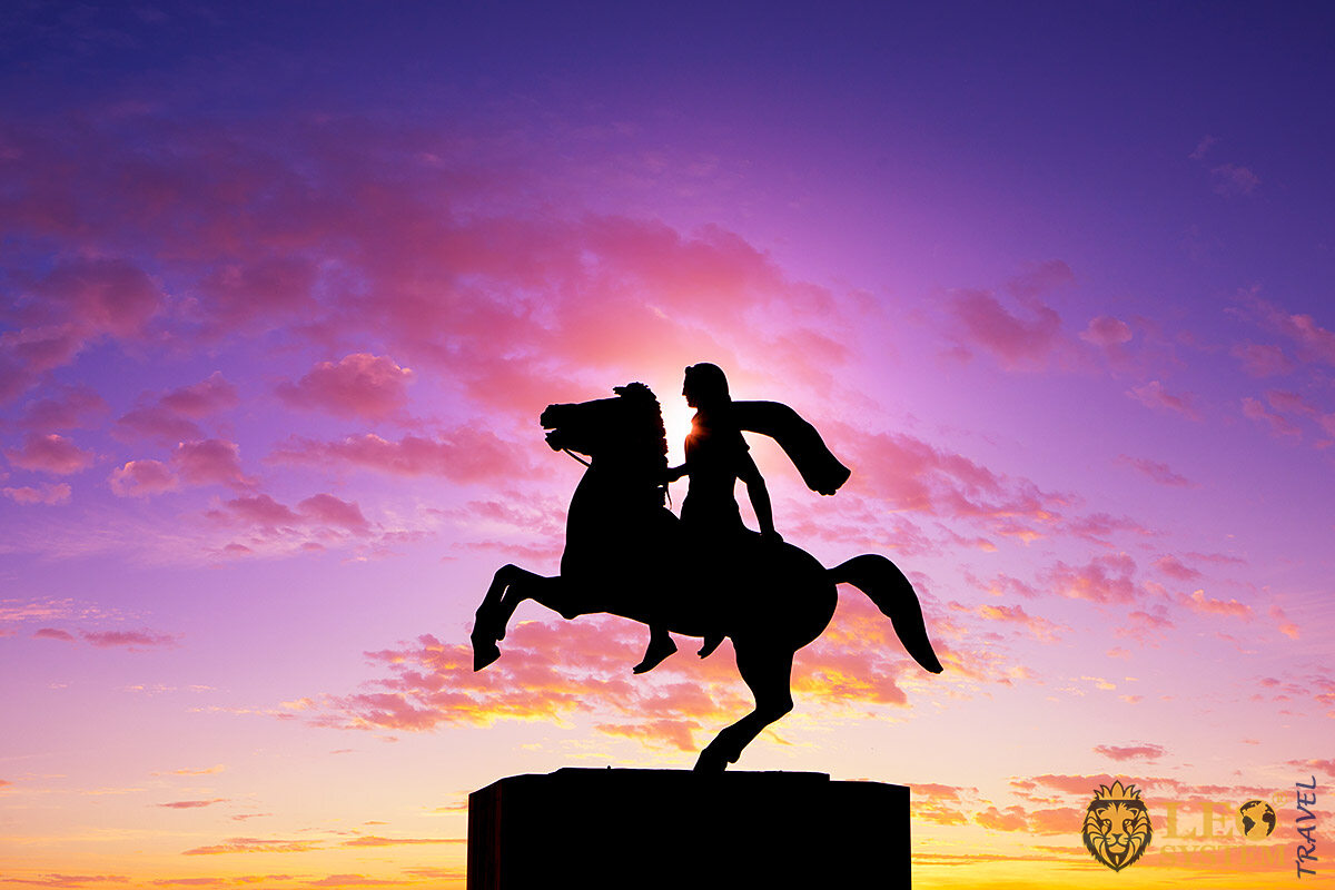 Image of the silhouette of the Statue of Alexander the Great at sunrise, Greece