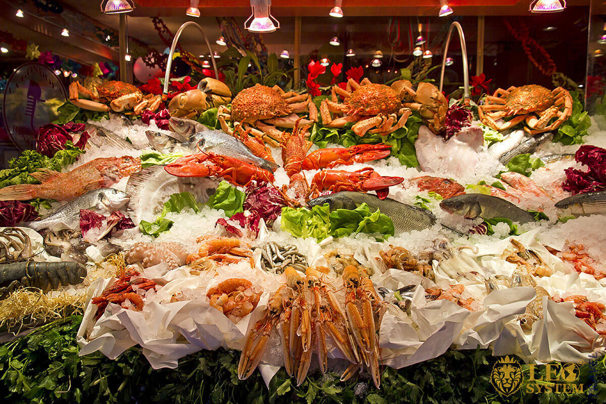 Image of a large table in a restaurant with various seafood, Italy