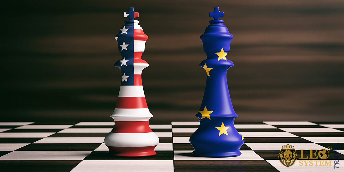 Chessboard with figures painted in the colors of the flags of America and Europe
