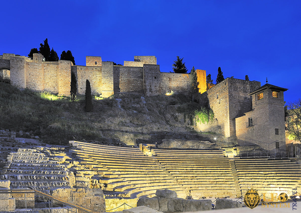 Night view of the old Roman theater in Malaga, Spain