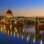 Evening view of the embankment and the bridge, city of Toulouse, France