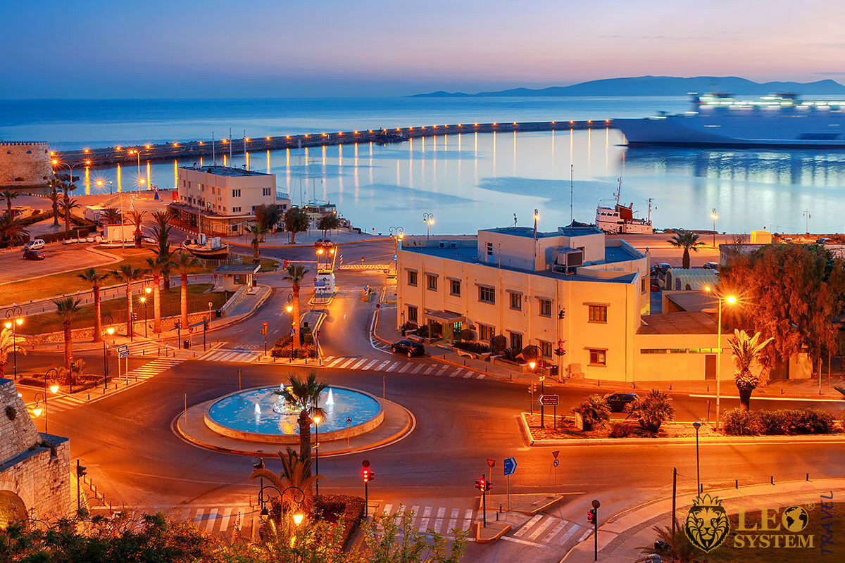 Evening panoramic view of city buildings and the seaport, Heraklion, Greece