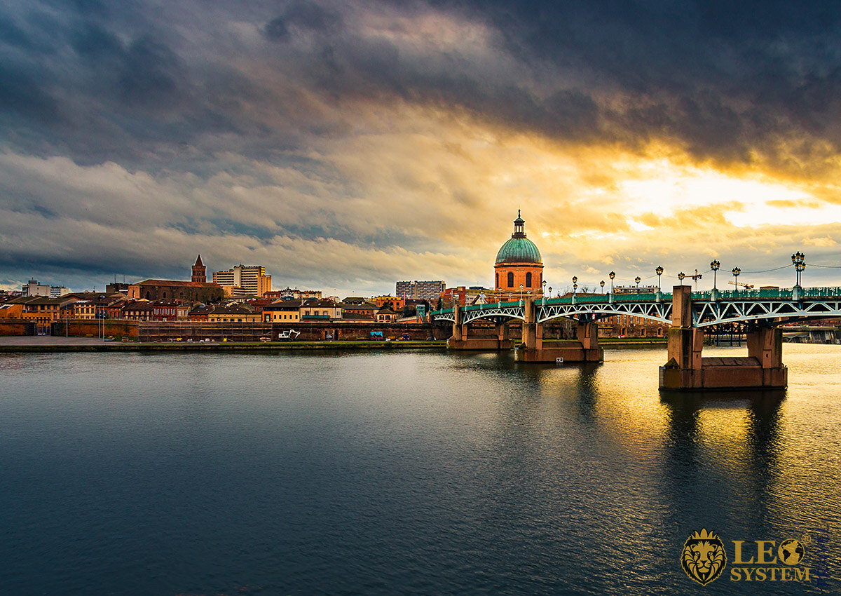 Stunning evening view of the Garonne River and city infrastructure, Toulouse, France