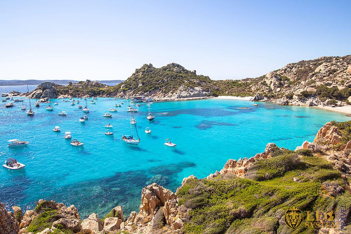 Image of the sea with yachts on a bright and sunny day, Sardinia, Italy