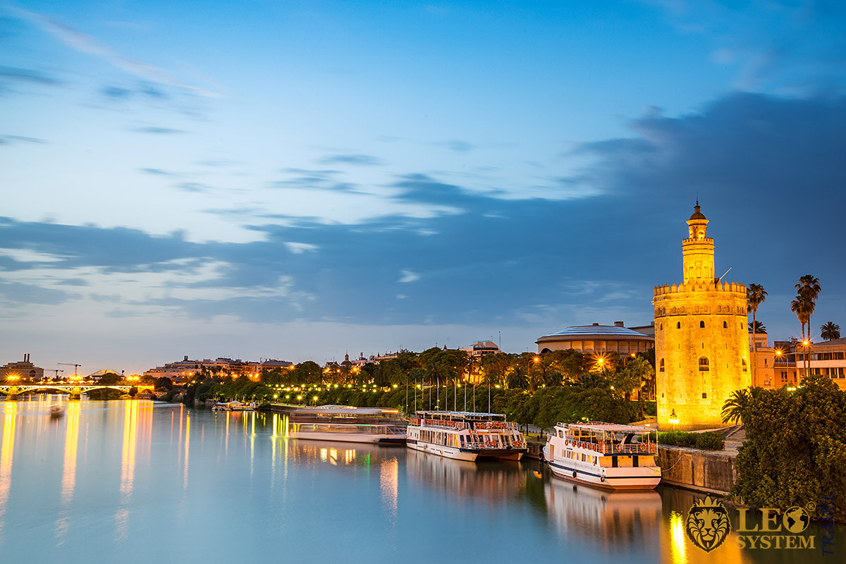 View of the Guadalquivir River and the Golden Tower at sunset, Seville, Spain
