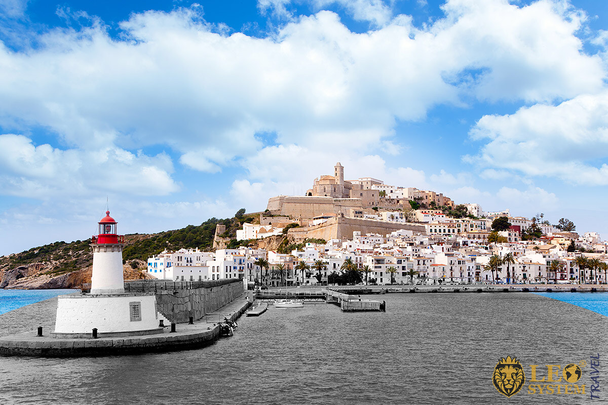 Image of the red lighthouse and buildings, Ibiza