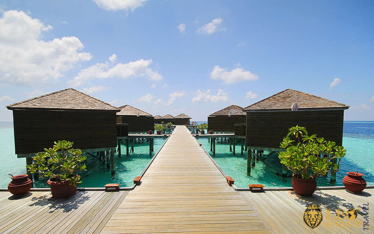 View of many bungalows and ocean, Vilamendhoo Island, Maldives