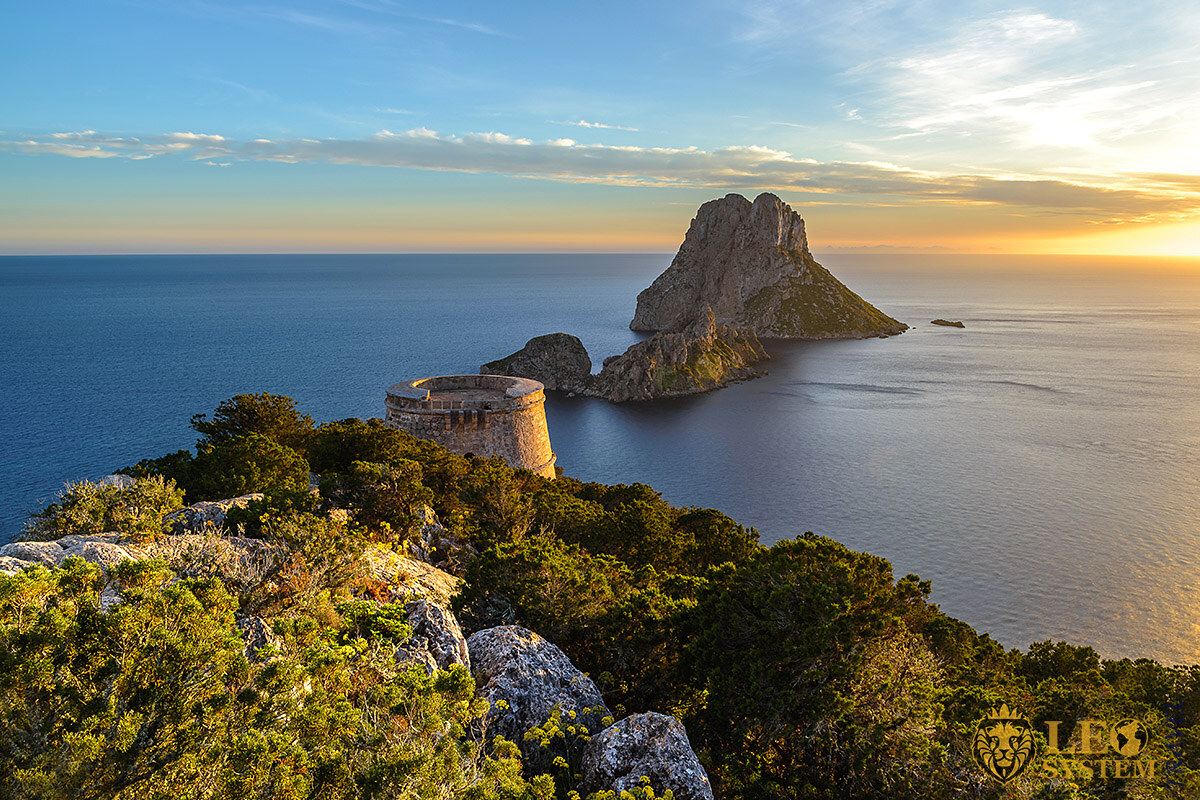 View of the tower and the sea at the time of sunset, Ibiza, Spain