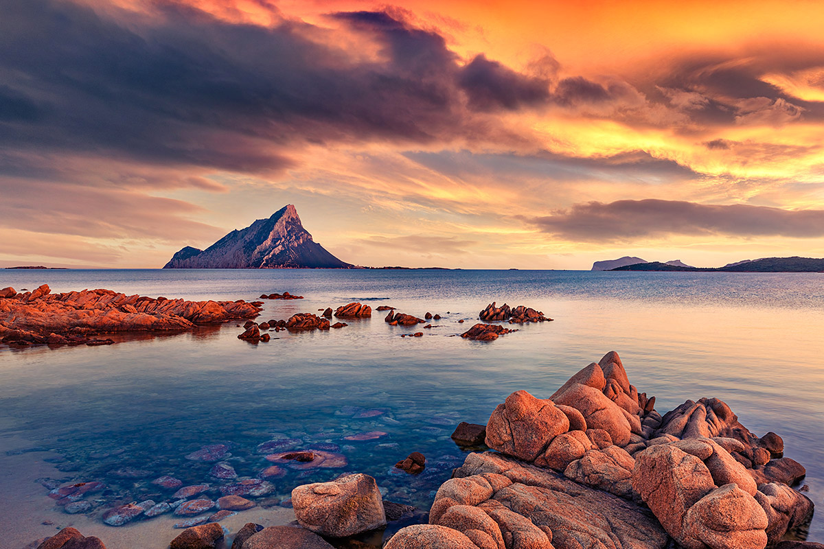 Beautiful views of the sea and mountains at the time of sunset, island of Sardinia, Italy