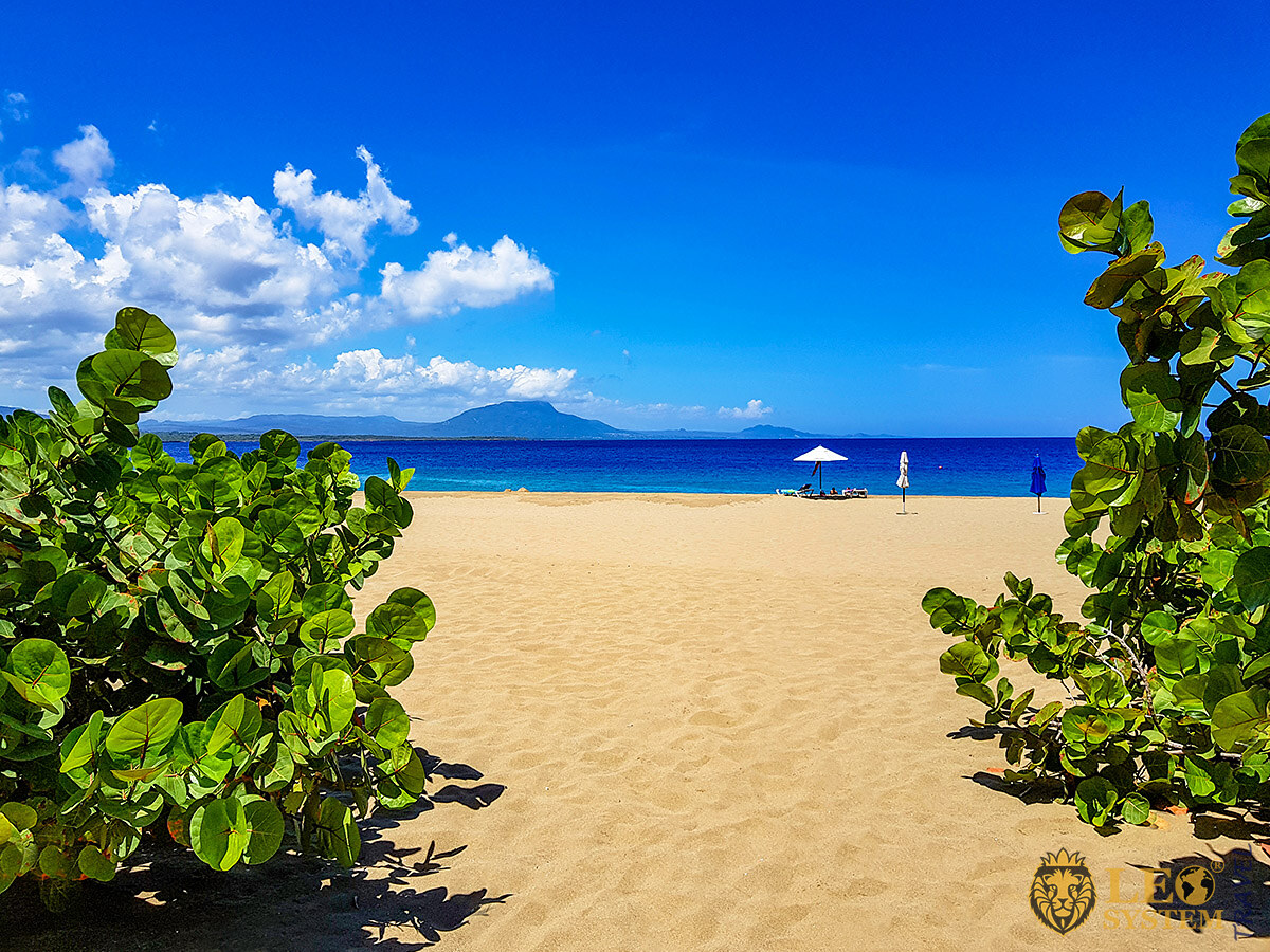 View of the beach and blue sky in the town of Sosua, Dominican Republic