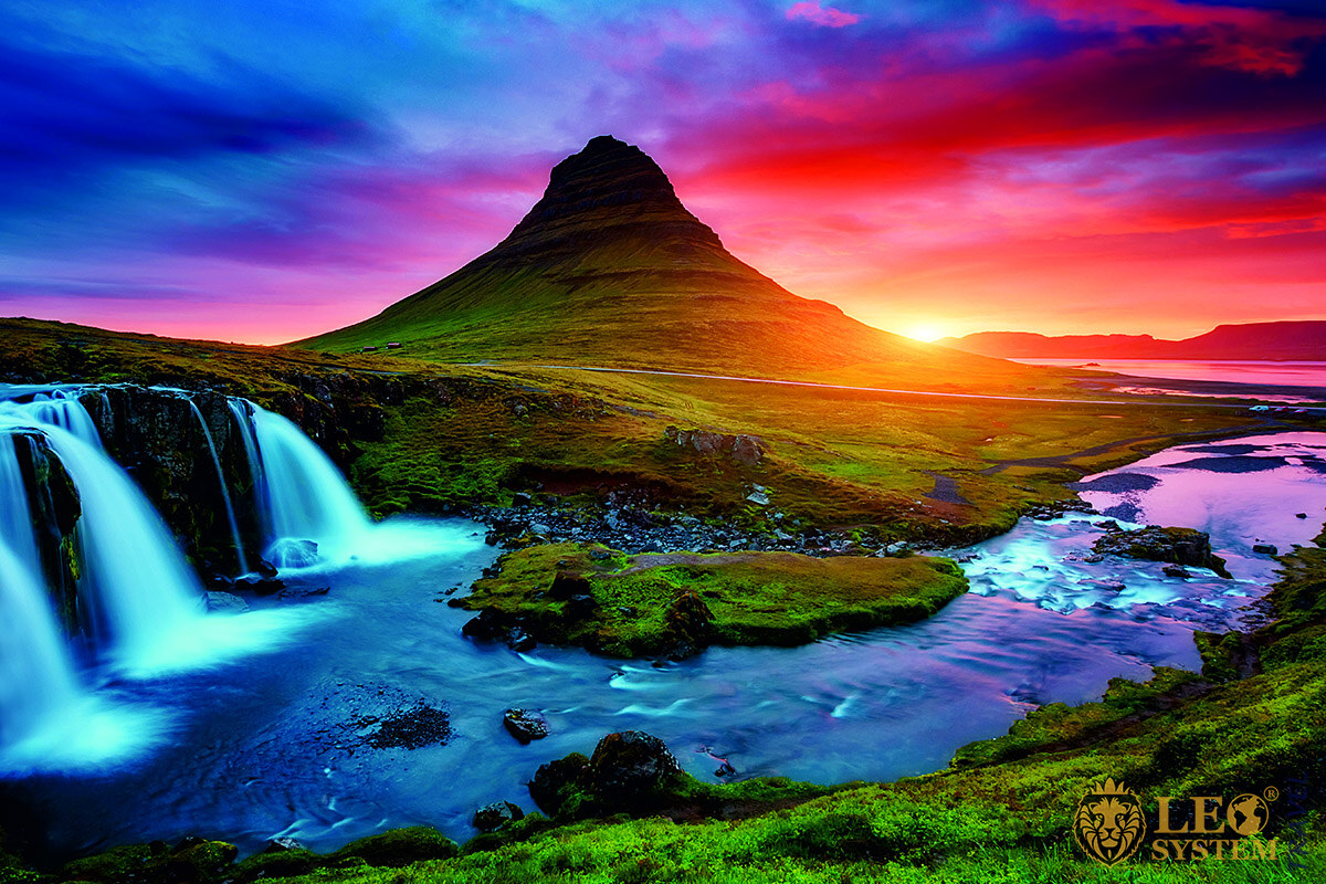 Beautiful view of the mountains and the waterfall at the time of sunset, Europe