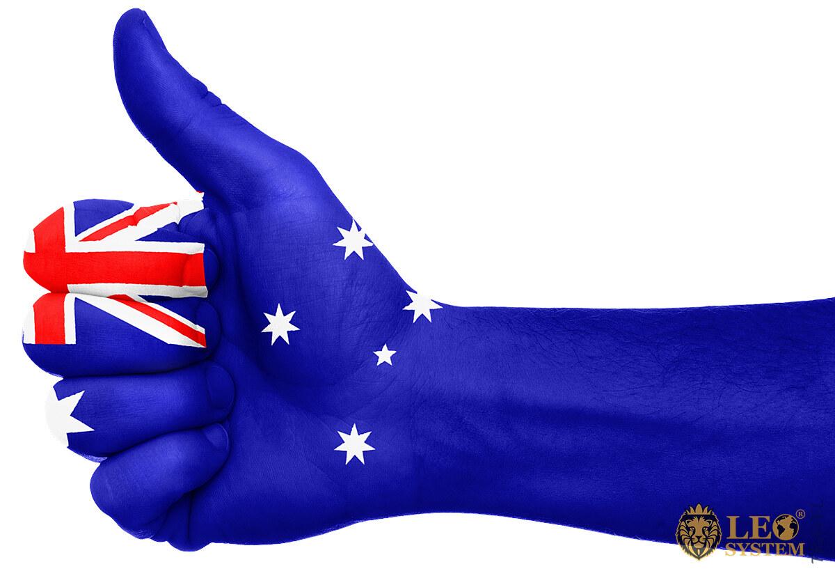 Human hand and flag of Australia