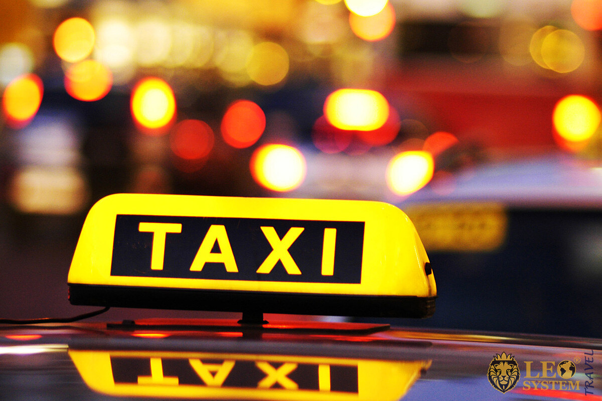 Image of a taxi in the night city